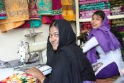 Photo showing two women in a sewing shop, Khaleda pictured in front was working in the Rana Plaza building (Dhaka, Bangladesh) when it collapsed on 24 April 2013, bringing international attention to working conditions in the garments industry.