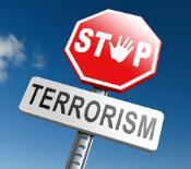 An image of a stop sign with the word terrorism under it