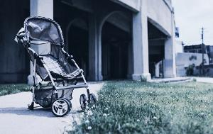 Abandoned stroller in desolate are symbolizes child neglect