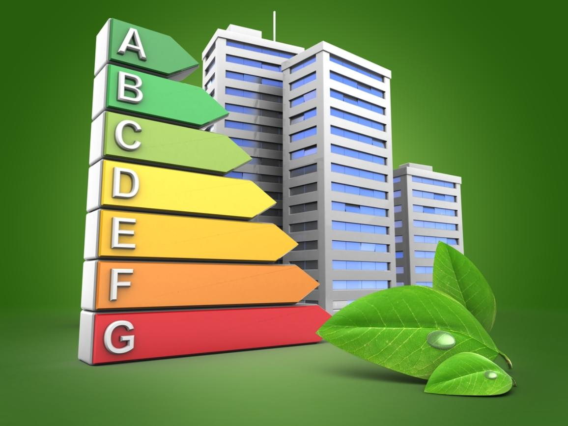 Energy ranking A to G over green background with buildings and leaf
