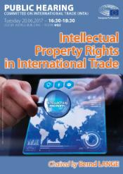 "Image of the world map with magnifying glass focused on phrase ""intellectual property"""