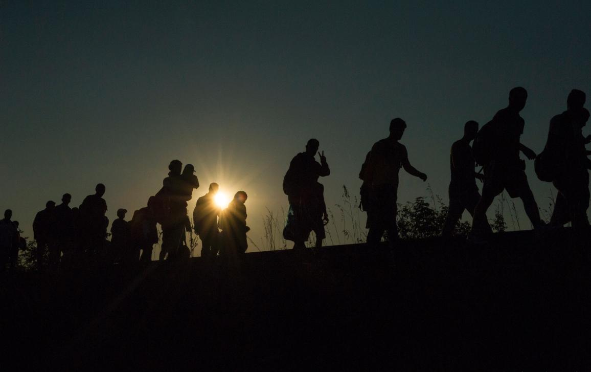 05_Migration:Hungary. Refugees walking along railway tracks soon after crossing the border. ©UNHCR/Mark Henley