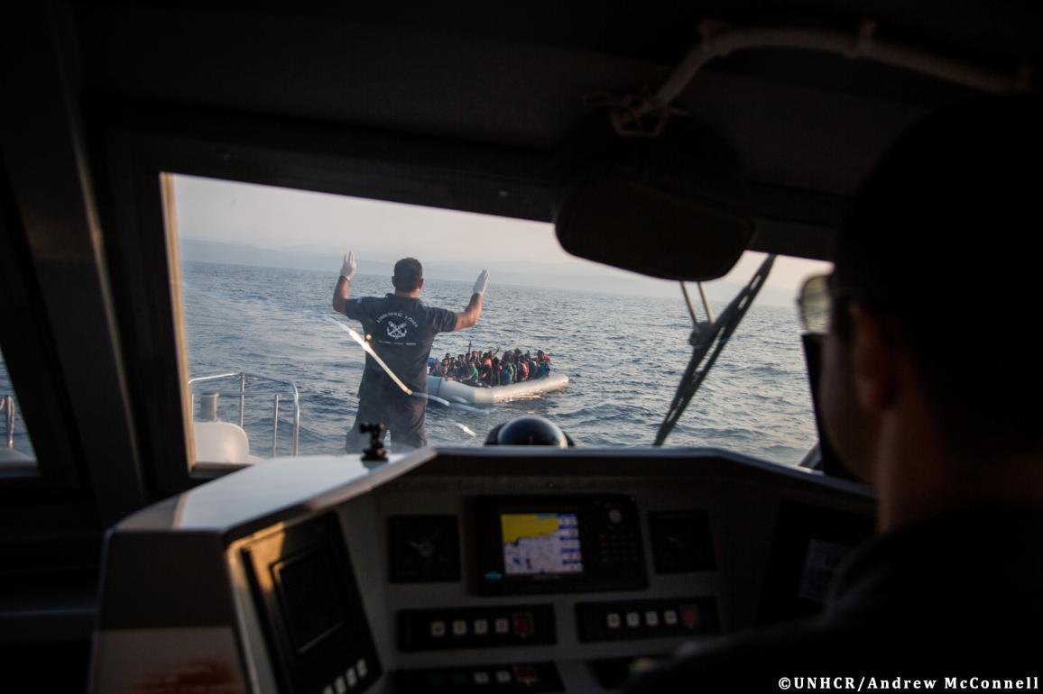 Greece's Hellenic Coast Guard approaches a boat containing 43 Syrian refugees in the Mediterranean sea, off the coast of Lesbos, Greece.