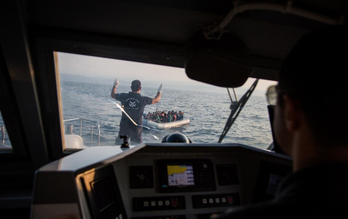 04_Migration: Greece's Hellenic Coast Guard approaches a boat containing 43 Syrian refugees in the Mediterranean sea, off the coast of Lesbos, Greece. © UNHCR/Andrew McConnell