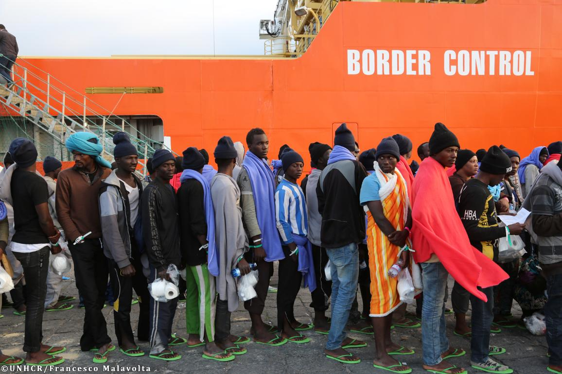 Migrants and refugees coming mostly from Sub-Saharan countries await at the dock of Catania port before being identified by the Italian authorities and Frontex.