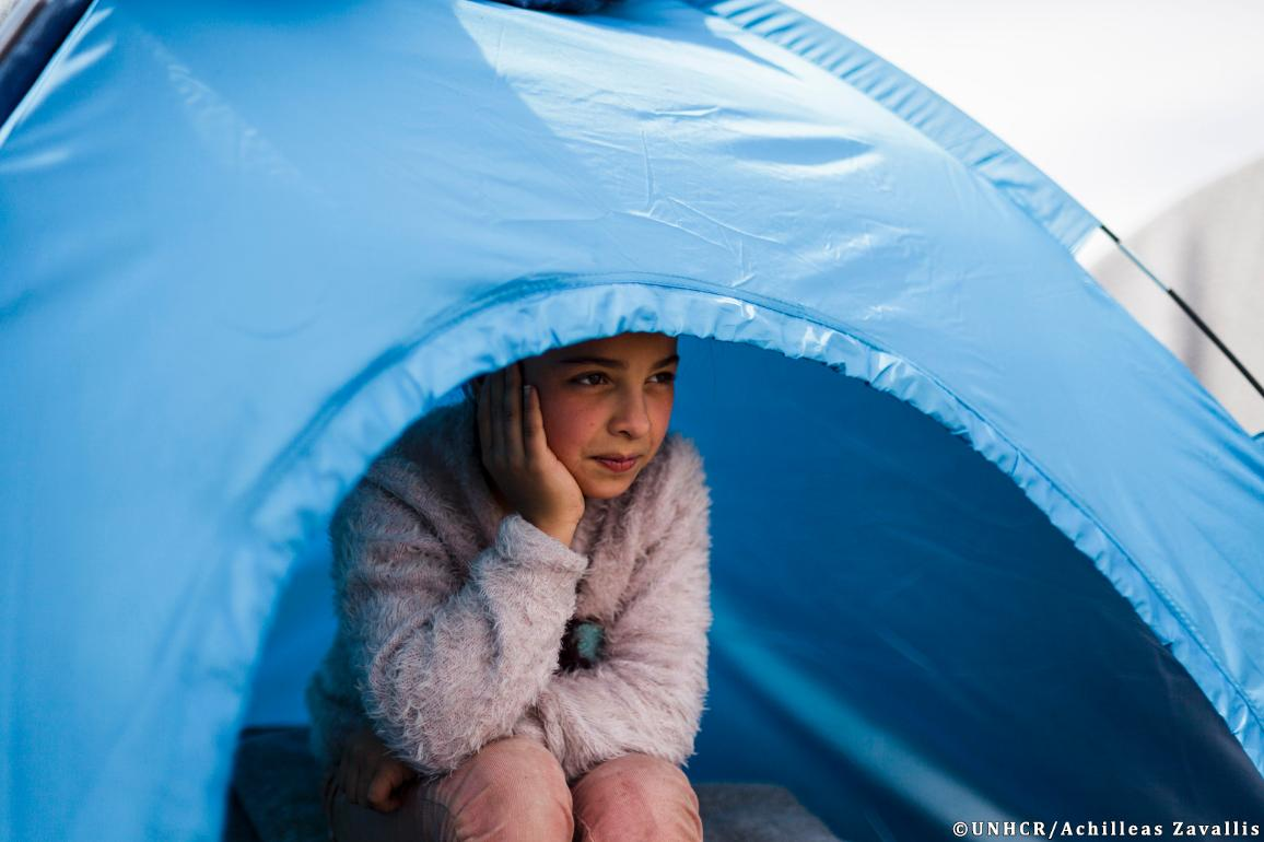 Improving the Common European Asylum System: Adiba (11) sits inside the small camping tent she shares with her mother and her 4 siblings while the family waits at the Idomeni transit station to cross into the Former Yugoslav Republic of Macedonia. ©UNHCR/Achilleas Zavallis