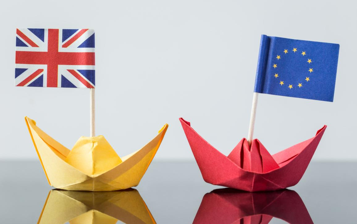 Two paper ships with British and European union flag