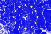 NATO white logo and EU 12 yellow stars painted on thorn cracked blue background