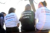 4 young people wearing European Solidarity Corps T-shirts having chat