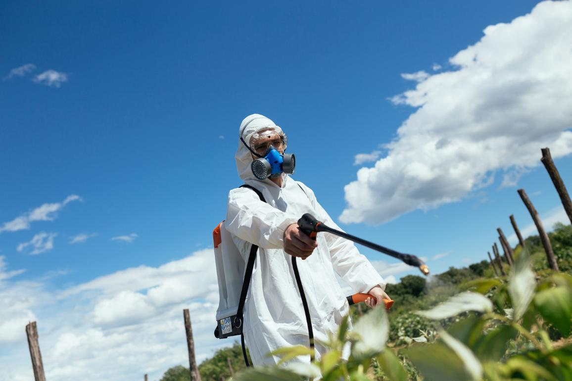 Man spraying toxic pesticides or insecticides on fruit growing plantation. ©AP Images/European Union-EP