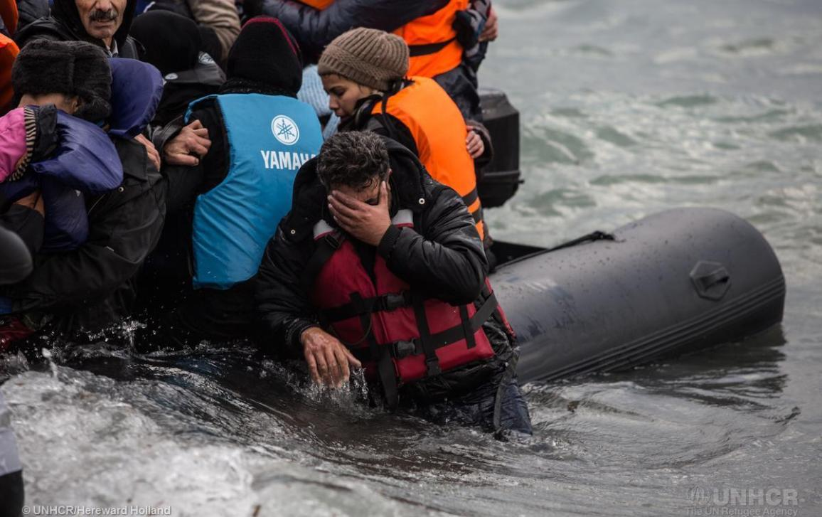 A male refugee cries as his boat comes ashore on the Greek island of Lesvos after crossing from Turkey. © UNHCR/Hereward Holland