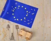 European Flag with small wooden tractor