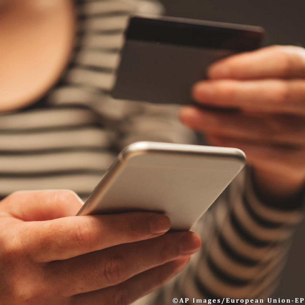 Debit card payment on mobile phone ©AP Images/European Union-EP