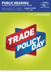 Green background with the title Trade Policy Day in white letters on red and blue stripes