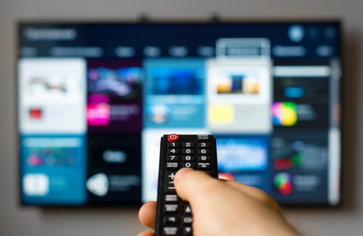 A man holding an online TV remote control ©AP Images/European Union-EP