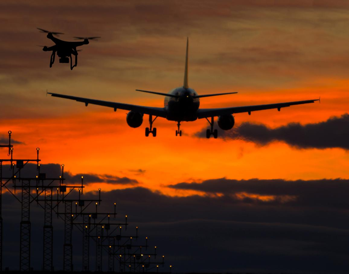 A drone is flying near a commercial airplane. ©AP Images/European Union-EP