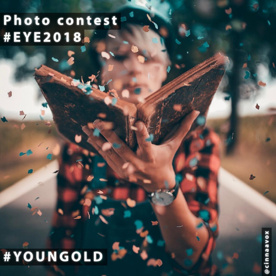 fotografia mladej ženy, ktorá drží knihu, z ktorej vyletujú farebné kúsky papiera.