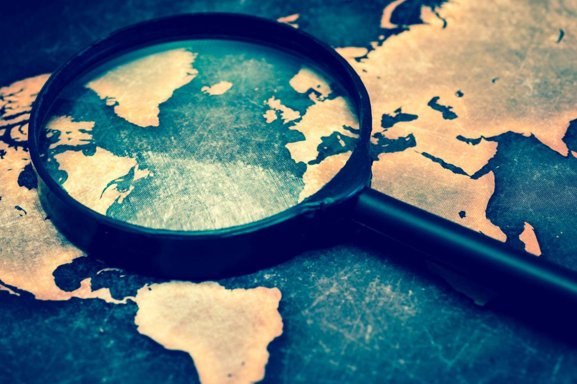 Magnifying lens on world map. ©AP Images/European Union-EP