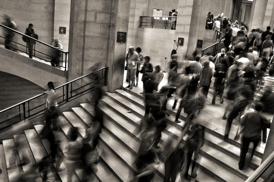 Busy stairs on a train station. Photo by José Martín Ramírez C on Unsplash
