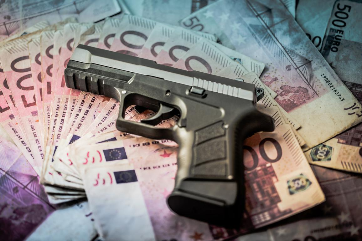 500 euros banknotes with a gun ©AP Images/European Union-EP