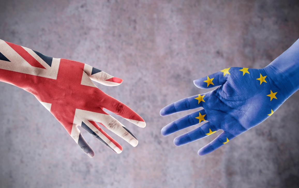 Image of two hands in the gesture to shake hands, painted in the colours of UK and EU flags