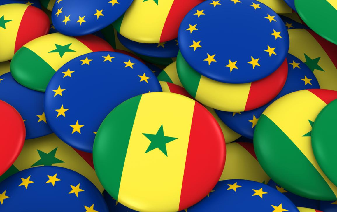 Pile of Senegalese and European Flag Buttons.