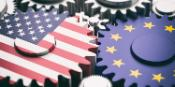 flags of the US and the EU represented as two meshing gears