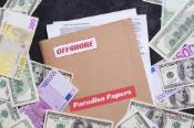 "Folder named ""paradise papers"" surrounded by money"