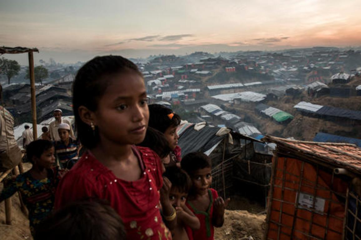 Young Rohingya refugees look out over Palong Khali refugee camp, a sprawling site located on a hilly area near the Myanmar border in south-east Bangladesh