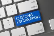"""Blue key of a computer keyboard with the text """"customs declaration"""" on it"""