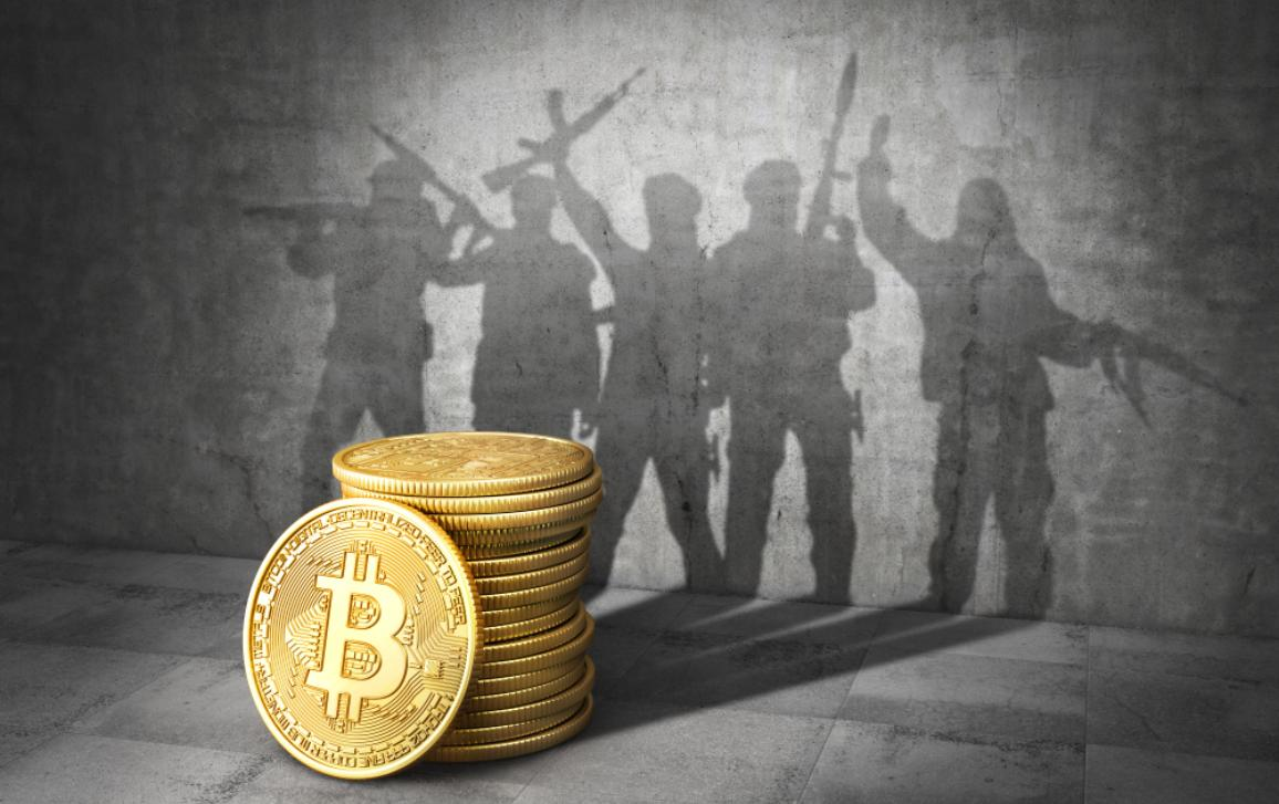 Stack of bitcoins in front of grey wall with shadow in form of a group of terrorists holding weapons