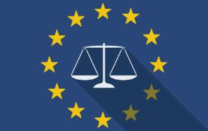 White scales on a blue background surrounded by the EU flag with yellow stars