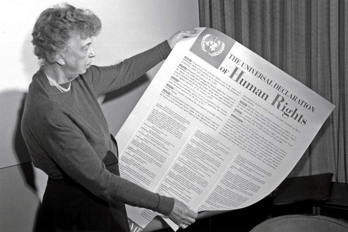 Eleanor Roosevelt, Chair of the UN Human Rights Commission 1946-1950, holding the Universal Declaration of Human Rights.
