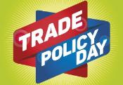 Image of two strips red and blue with white letters stating trade policy day