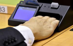 Hand on a voting machine