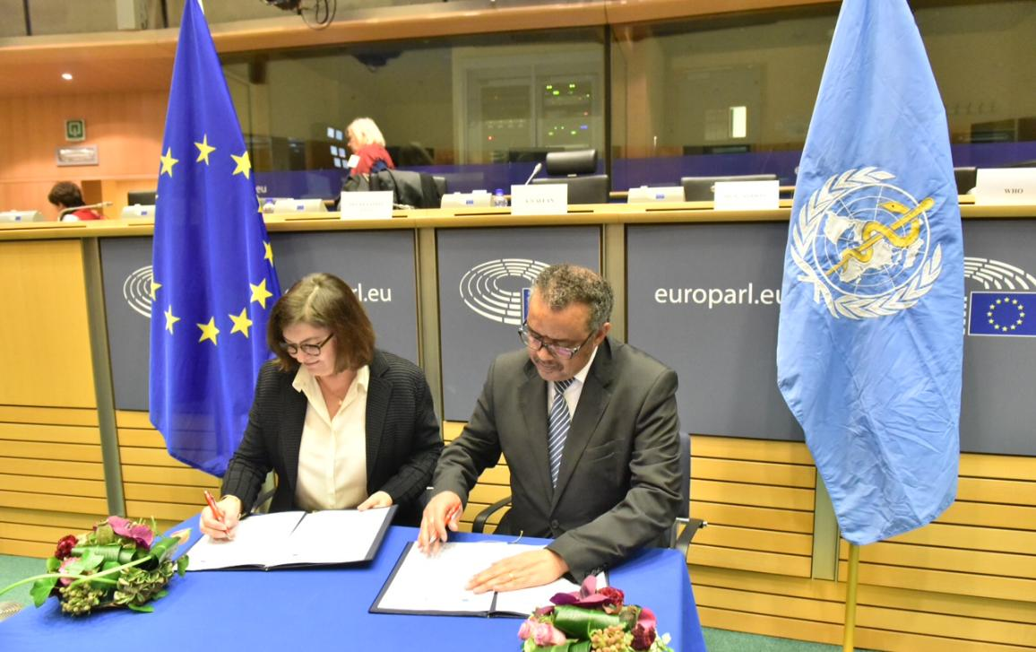 Picture in the meeting room of Dr Tedros Adhanom Ghebreyesus and Ms Ioana-Adina Vãlean (ENVI Chair) signing the EP and WHO joint statement