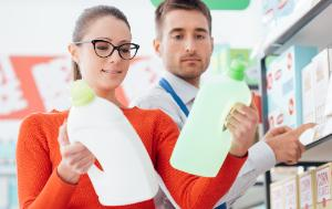 Woman and man looking at household products in a supermarket