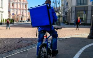 Courier On Bicycle Delivering Food ©AP images/European Union - EP