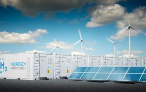 Hydrogen tanks, wind turbines and solar panels under a blue and cloudy sky
