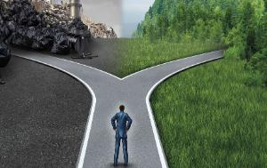Climate choice concept as a person standing at a cross road between an unhealthy scene with polluted dirty air contrasted with a green healthy horizon of plants and clean air for global ecology