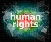 The words human rights on a digital background with the world map