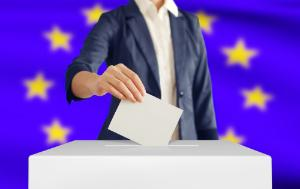 Woman putting a ballot into a voting box with European Union flag in background