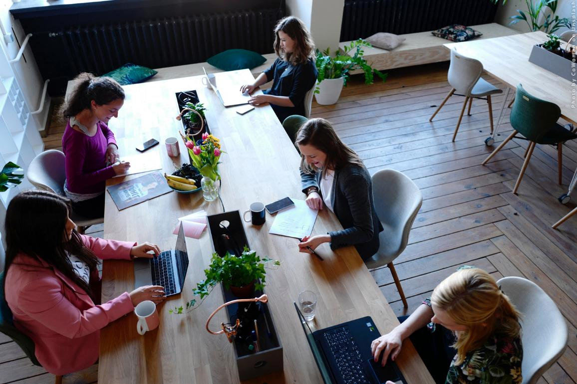 Young people are working in a coworking space. Photo by CoWomen on Unsplash