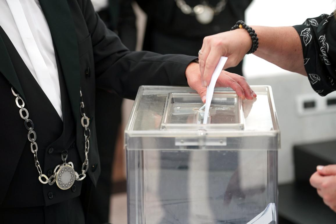 A member of the Parliament casting his vote to elect the Vice-Presidents of the EP
