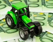 Tractor toy put on banknotes