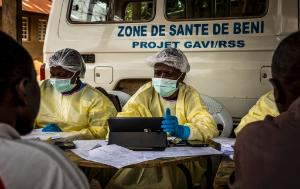 Health workers register people who have been in touched with other people who got Ebola infected. before vaccinating them.