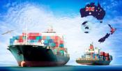Cargo ships on blue sky background with flags of Australia and New Zealand