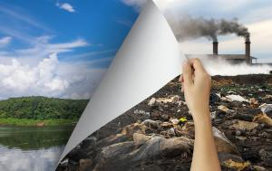 Woman hand turning pollution page revealing nature landscape