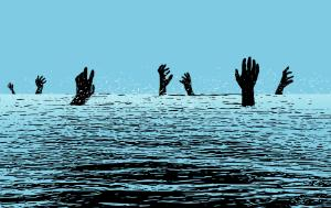 Hands of people drowning in the sea