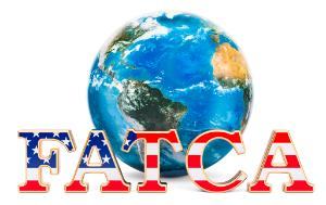 FATCA, Foreign Account Tax Compliance Act concept - written text FATCA, world globe in background